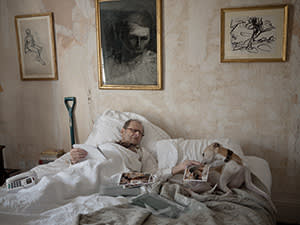 Freud and Eli the dog with works by Frank Auerbach on the wall