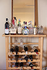 Liquor cabinet in home of 24 year old Codecademy founder Zach Sims. New York City