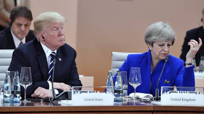 US President Donald Trump, left, and Britain's Prime Minister Theresa May wait for the start of the first working session of the G-20 meeting in Hamburg, northern Germany, on Friday, July 7, 2017. (John MacDougall/Pool Photo via AP)