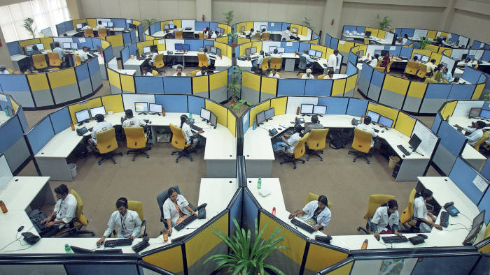 Indian staff work at a call centre for The Emergency Management and Research Institute (EMRI) in Hyderabad
