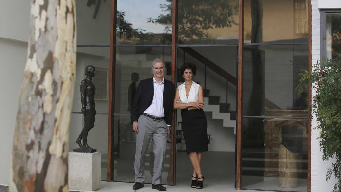 Fernanda Feitosa and her husband photographed at their home in Sao Paolo with artwork
