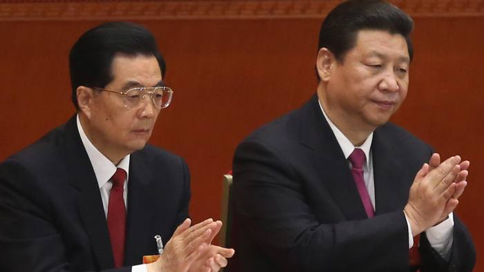 BEIJING, CHINA - MARCH 17: Former Chinese president Hu Jintao (L) and newly-elected Chinese President Xi Jinping (R) attend the closing session of the National People's Congress (NPC) at the Great Hall of the People on March 17, 2013 in Beijing, China. China's newly-elected president Xi Jinping pledged Sunday to resolutely fight against corruption and other misconduct in all manifestations. (Photo by Feng Li/Getty Images)