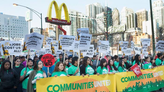 CHICAGO, IL - APRIL 14: Demonstrators demanding an increase in the minimum wage to $15-dollars-per-hour march around a McDonald's restaurant on April 14, 2016 in Chicago, Illinois. The demonstrators marched to and protested in front of several locations during a day-long effort to draw attention to low-wage jobs. The demonstration was one of about 300 scheduled to take place nationwide today. (Photo by Scott Olson/Getty Images)