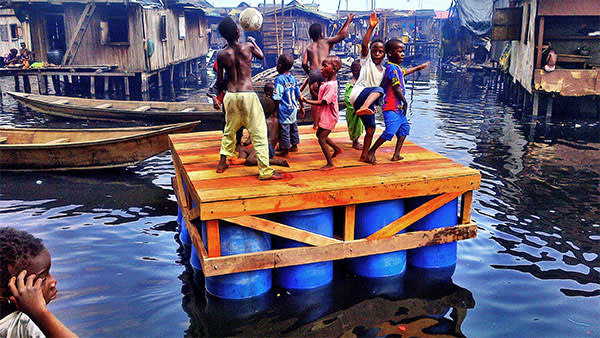 Children dancing on a platform in Makoko
