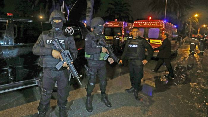 epa05040093 Police and rescue forces at the scene of an explosion in Tunis, Tunisia, 24 November 2015. Eleven members of the Tunisian presidential security service were killed when an explosion hit their bus in the capital Tunis, Interior Ministry spokesman Walid al-Wuqaini told state television. Fourteen other people were injured, and the cause of the explosion was not yet known, the broadcaster said, citing an unnamed security official. EPA/MOHAMED MESSARA