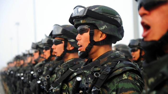 Paramilitary policemen stand in formation as they take part in an anti-terrorism oath-taking rally, in Kashgar, Xinjiang Uighur Autonomous Region, China, February 27, 2017. Picture taken February 27, 2017. REUTERS/Stringer ATTENTION EDITORS - THIS IMAGE WAS PROVIDED BY A THIRD PARTY. EDITORIAL USE ONLY. CHINA OUT. NO COMMERCIAL OR EDITORIAL SALES IN CHINA. REUTERS/Stringer CHINA OUT. NO COMMERCIAL OR EDITORIAL SALES IN CHINA