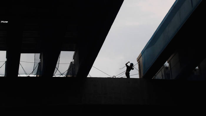 An Indonesian laborer works at a construction site in Jakarta, Indonesia, 25 July 2016