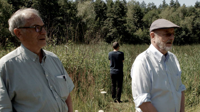 Horst von Wächter, Philippe Sands (facing away) and Niklas Frank on the edge of a mass grave site near Zolkiew, western Ukraine, in a scene from Sands' film 'My Nazi Legacy'