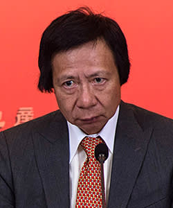 Thomas Kwok, co-chairman of Sun Hung Kai Properties Ltd., pauses as he listens during the company's news conference in Hong Kong, China, on Friday, Sept. 12, 2014