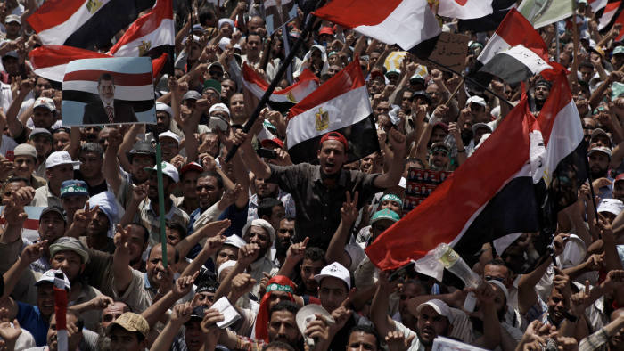 Supporters of President Morsi gather at a rival demonstration at the Rabaa al-Adaweya Mosque in the Cairo suburb of Nasr City