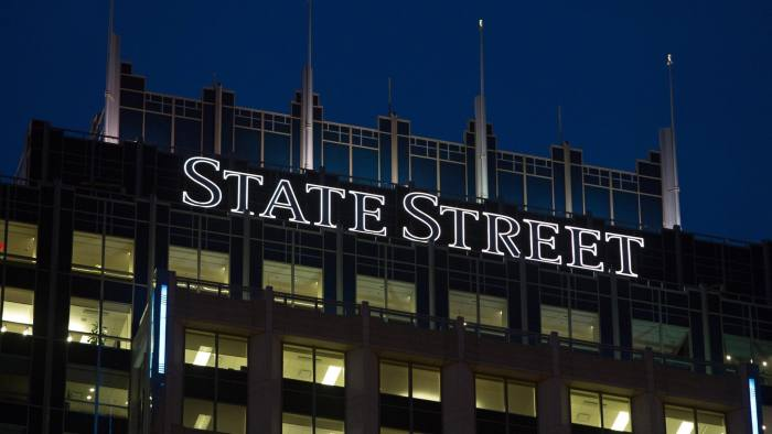 Views Of State Street Corp. Headquarters Ahead Of Earnings Figures...Signage for State Street Corp. is illuminated atop the State Street Financial Center building, which houses the company's headquarters, in Boston, Massachusetts, U.S., on Monday, Oct. 15, 2012. State Street Corp. is scheduled to release earnings data on Oct. 16, 2012. Photographer: Scott Eisen/Bloomberg