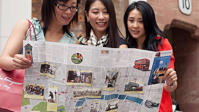 Chinese tourists view the Eastsong map of luxury London shopping destinations