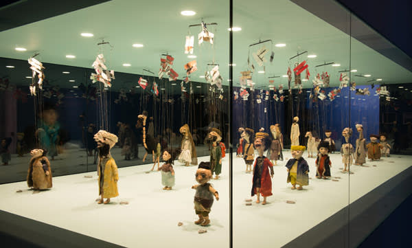 Marionettes in an installation at the gallery, which also features the artist's films