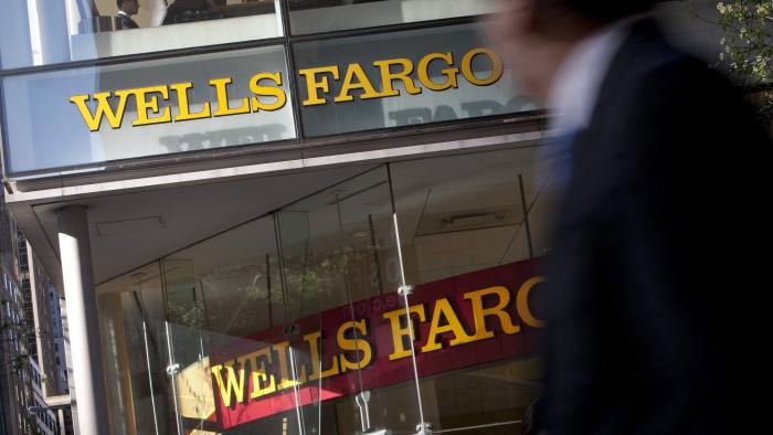 Wells Fargo Profit Rises as Results Improve on Mortgages...Pedestrians walk past a Wells Fargo & Co. bank branch in New York, U.S., on Friday, April 13, 2012. Wells Fargo & Co., the largest U.S. home lender, reported a 13 percent rise in first-quarter profit, setting a record as the bank made more money on new mortgages and curbed losses from old ones. Photographer: Scott Eells/Bloomberg