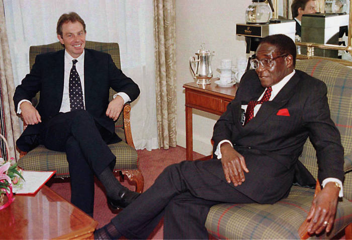 File photo dated 24/10/97 of Tony Blair (left) and Robert Mugabe, whose legacy as one of the most ruthless tyrants of modern times will remain long after his days as notorious statesman of Zimbabwe are over. PRESS ASSOCIATION Photo. Issue date: Wednesday November 15, 2017. What could turn out to be the 93-year-old leader's final night in charge of the troubled south African nation concluded in typically chaotic fashion with the army saying it had Mugabe and his ambitious wife Grace in custody following a takeover of the state broadcaster. See PA story POLITICS Zimbabwe Profile. Photo credit should read: PA Wire