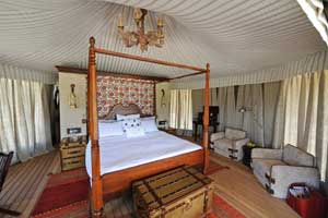 One of the bedroom tents with a four-poster