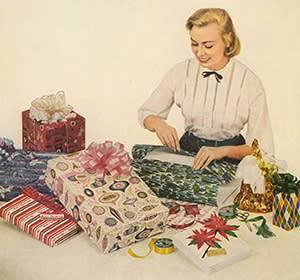 A woman wrapping gifts
