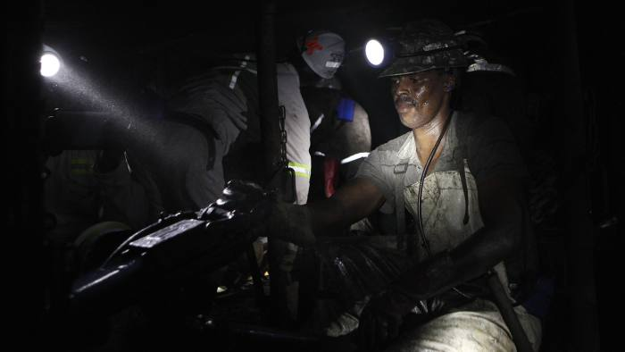 A miner is seen underground at Lonmin Plc's Karee mine in Marikana, Rustenburg...A miner is seen underground at Lonmin Plc's Karee mine in Marikana, Rustenburg 100 km (62 miles) northwest of Johannesburg, March 5, 2013. Thousands of miners remained on strike at two shafts in South Africa's Marikana platinum mine on Tuesday, operator Lonmin Plc said, revising an earlier statement that they had gone back to work. REUTERS/Siphiwe Sibeko (SOUTH AFRICA - Tags: CIVIL UNREST POLITICS BUSINESS) - RTR3ELLX