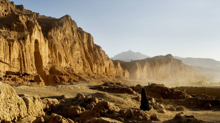A woman at the site in the Bamiyan valley where the ancient statues of Buddha once stood