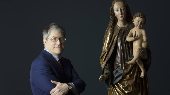 Andrew Butterfield, who has devoted years to researching sculptures, with one of his discoveries in New York