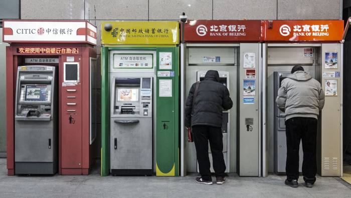 People use automated teller machines (ATMs) in Beijing, China, on Tuesday, Jan. 19, 2016. China's economy slowed in December, capping the weakest quarter of growth since the 2009 global recession, as the Communist leadership struggles to manage a transition to consumer-led expansion. Photographer: Qilai Shen/Bloomberg
