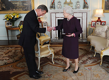 Queen Elizabeth II presents the Order of Merit to Neil MacGregor, the Director of the British Museum at Buckingham Palace in London March 2011