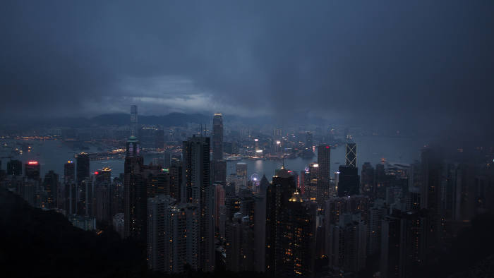 Illuminated buildings shrouded in haze are seen from Victoria Peak at dusk in Hong Kong, China, on Friday, Jan. 22, 2016