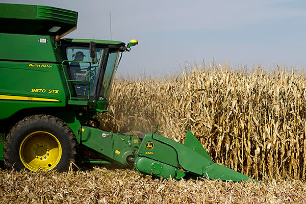 Corn is harvested with a John Deere 9670 STS combine harvester outside Malden, Illinois, U.S., on Thursday, Oct. 10, 2013.
