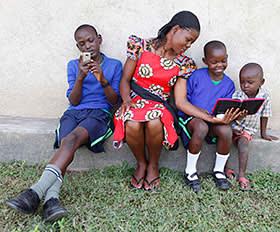 A teacher and pupils in Kisumu, Kenya