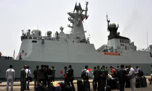 epa04693946 Chinese people and diplomats wait to board a Chinese navy frigate to depart for their country during an evacuation from Yemen at a sea port in the western port city of Hodeidah, Yemen, 06 April 2015. According to reports China said on 06 April it has temporarily closed its embassy in the Yemeni capital Sana'a and its consulate general in the southern city of Aden, and evacuated all diplomatic staff from Yemen due to the worsening security conditions. The Saudi-led military operation launched airstrikes against the Houthi rebels in Yemen on 26 March. EPA/STRINGER
