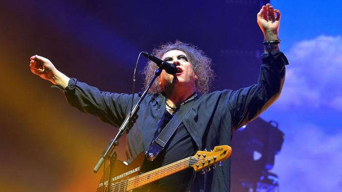 Robert Smith of The Cure on stage at Wembley Arena