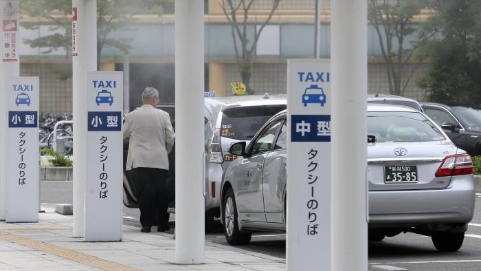 A man boards a taxi in Niigata, Niigata Prefecture, Japan, on Wednesday, Aug. 3, 2016. In attempting to hit a 2 percent annual inflation target, the Bank of Japan has expanded its balance sheet to more than 80 percent of gross domestic product, far further than similar stimulus efforts in Europe or the U.S. have gone. Photographer: Yuriko Nakao/Bloomberg