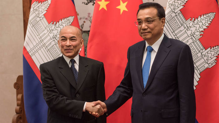 China's Premier Li Keqiang (right) shakes the hand of Cambodia's King Norodom Sihamoni at the Great Hall of the People in Beijing on June 3 2016