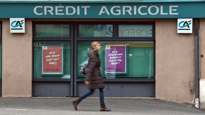 A pedestrian passes a Credit Agricole SA bank branch in Rodez, France. Photographer: Balint Porneczi/Bloomberg