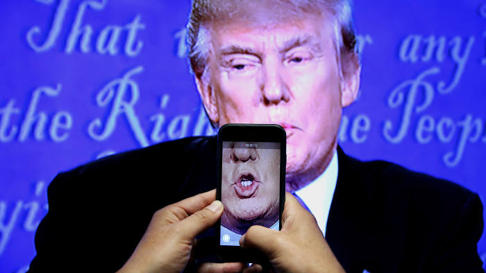 A journalist records US presidential nominee Donald Trump at the first television debate with rival Hillary Clinton in
