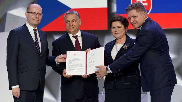Czech Republic's Prime Minister Bohuslav Sobotka, Hungary' Prime Minister Viktor Orban, Poland's Prime Minister Beata Szydlo and Slovakia's Prime Minister Robert Fico show signed Warsaw's declaration