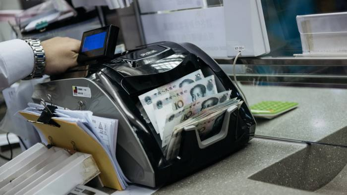 An employee uses a machine to count Chinese ten yuan banknotes at the Professional Foreign Currency Exchange Ltd. (PFCE) store in Hong Kong, China, on Thursday, March 16, 2017. Hong Kong's shopping districts are dotted with money changers advertising their remittance services and conversion rates. There are 1,891 licensed money operators in the city, Hong Kong customs data show. Photographer: Anthony Kwan/Bloomberg