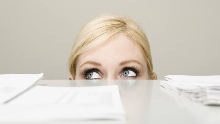 Woman behind filing cabinet