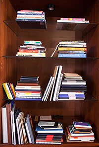 Bookcase in home of 24 year old Codecademy founder Zach Sims. New York City