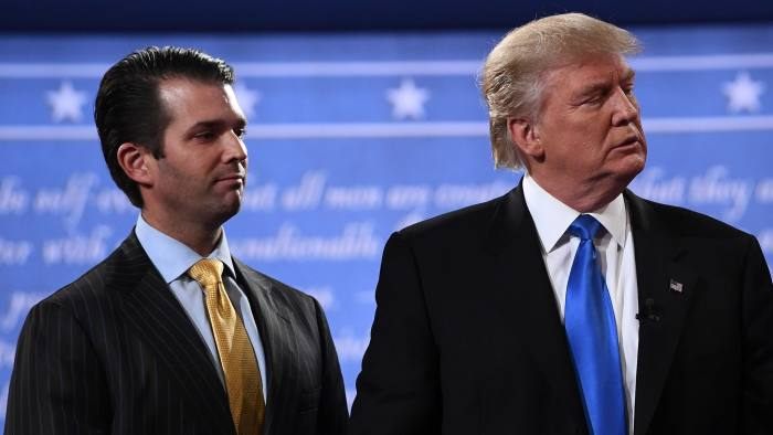 (FILES) This file photo taken on September 26, 2016, shows Republican nominee Donald Trump (R) standing with his son Donald Trump Jr. after the first presidential debate at Hofstra University in Hempstead, New York. Donald Trump Jr. admitted on July 10, 2017, to meeting a Russian lawyer in a bid to get dirt on his father's 2016 rival Hillary Clinton, plunging the White House into another Russia-related scandal. Trump Jr., confirmed reports that he was seeking compromising information on Clinton when he met Russian attorney Natalia Veselnitskaya in June 2016. / AFP PHOTO / Jewel SAMADJEWEL SAMAD/AFP/Getty Images