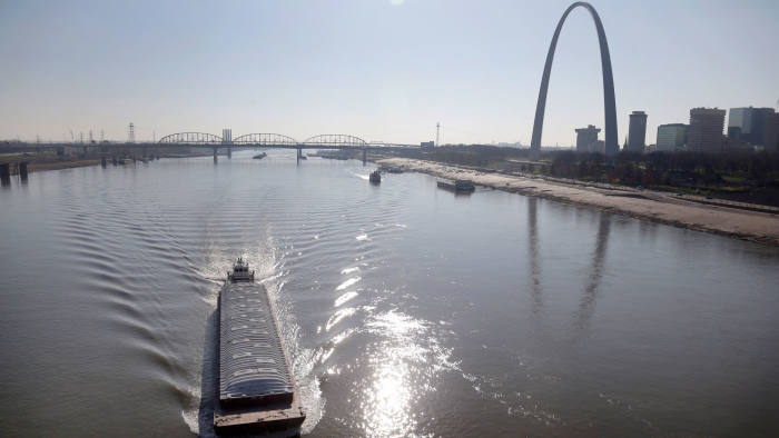 A barge powers its way up the Mississippi River Friday, Nov. 16, 2012