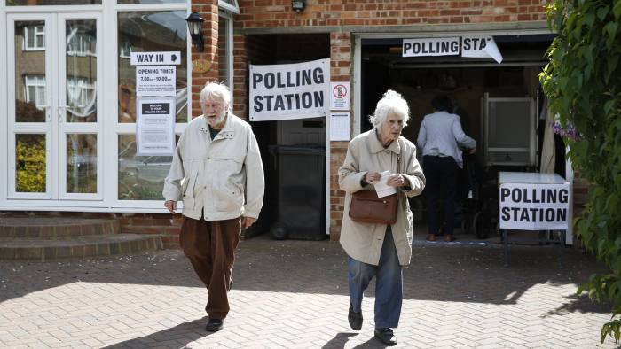 Members of the public vote at a polling station set up in the garage of a house in Croydon on May 7, 2015, as Britain holds a general election. Polls opened today in Britain's closest general election for decades with voters set to decide between the Conservatives of Prime Minister David Cameron, Ed Miliband's Labour and a host of smaller parties. AFP PHOTO / ADRIAN DENNIS (Photo credit should read ADRIAN DENNIS,ADRIAN DENNIS/AFP/Getty Images)