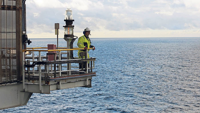 An employee looks out across the North Sea natural gas and oil field from the Troll A gas platform, operated by Statoil ASA, in the North Sea offshore from Bergen, Norway, on Thursday, Oct. 11, 2012