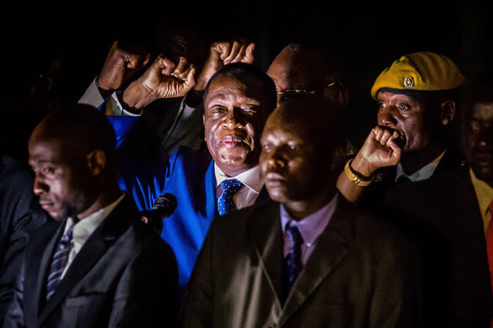 TOPSHOT - Zimbabwe's incoming President Emmerson Mnangagwa (2nd L) gestures as he speaks to supporters at Zimbabwe's ruling Zanu-PF party headquarters in Harare on November 22, 2017. Zimbabwe's former vice president Emmerson Mnangagwa flew home on November 22 to take power after the resignation of Robert Mugabe put an end to 37 years of authoritarian rule. Mnangagwa will be sworn in as president at an inauguration ceremony on November 24, officials said. / AFP PHOTO / Jekesai NJIKIZANAJEKESAI NJIKIZANA/AFP/Getty Images