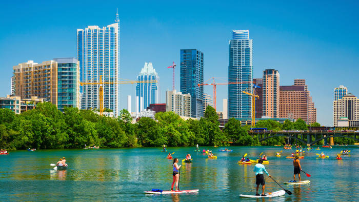 Paddle boarding and boating on Lady Bird lake in downtown Austin