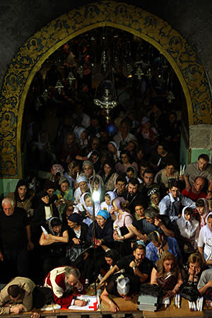 Orthodox Christians take part in the 'holy fire' Easter ceremony at the Church of the Holy Sepulchre in Jerusalem's Old City