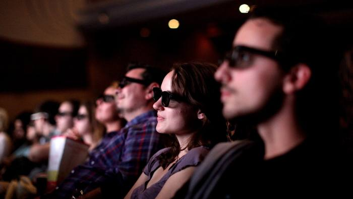 Customers wear 3D glasses as they watch Harry Potter and the Deathly Hallows - part 2 at the Odeon cinema on Leicester Square, in London, U.K., on Friday, July 15, 2011. BC Partners Ltd. and Omers Private Equity Inc. submitted a final offer to buy the Odeon and UCI cinema chain from Guy Hands Õs Terra Firma Capital Partners Ltd., said two people with knowledge of the matter. Photographer: Simon Dawson/Bloomberg