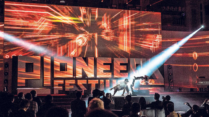 a dancing robot on stage at the Pioneers Festival