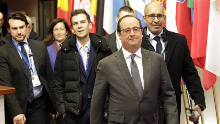 French President Francois Hollande, second right, leaves the building with his delegation after an EU summit in Brussels on Friday, Feb. 19, 2016. British Prime Minister David Cameron faces tough new talks with European partners after through-the-night meetings failed to make much progress on his demands for a less intrusive European Union. (AP Photo/Francois Walschaerts)