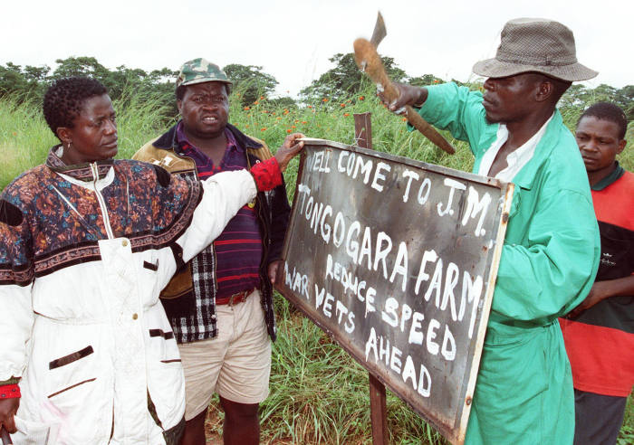 ZIMBABWE - MARCH 15: Independance war veterans rename Parklands Farm, 25 kilometers south west of the capital Harare 15 March 2000 after liberation war hero Josiah Tongogara. There has been resurgence of invasions of white owned farms by Zimbabwe's independance war veterans and only President Robert Mugabe can put a stop to them. (Photo credit should read PAUL CADENHEAD/AFP/Getty Images)